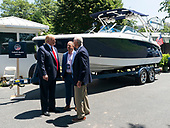 July 15, 2019 - Washington, DC, United States: United States President Donald J. Trump speaks with executives from Cobalt Boats about their boat on display at the 3rd Annual Made in America Product Showcase at the White House.<br /> Credit: Chris Kleponis / Pool via CNP