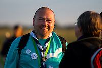 Photographer Anders Forssell in the sunset before the IST opening ceremony. Photo: Magnus Fröderberg/Scouterna