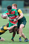 Apensia Sailo gets tackled by Josh Baverstock and Cody White. Counties Manukau Premier Club rugby game between Pukekohe and Waiuku, played at Colin Lawrie Fields, Pukekohe on Saturday April 14th, 2018. Pukekohe won the game 35 - 19 after leading 9 - 7 at halftime.<br /> Pukekohe Mitre 10 Mega -Joshua Baverstock, Sione Fifita 3 tries, Cody White 3 conversions, Cody White 3 penalties.<br /> Waiuku Brian James Contracting - Lemeki Tulele, Nathan Millar, Tevta Halafihi tries,  Christian Walker 2 conversions.<br /> Photo by Richard Spranger