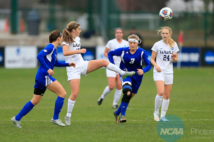 KANSAS CITY, MO - DECEMBER 03:  Liv Larson (18) of Western Washington University passes the ball against Grand Valley State University during the Division II Women's Soccer Championship held at Children's Mercy Victory Field at Swope Soccer Village on December 03, 2016 in Kansas City, Missouri. Western Washington University beat Grand Valley State University 3-2 to win the national title.  (Photo by Jack Dempsey/NCAA Photos via Getty Images)