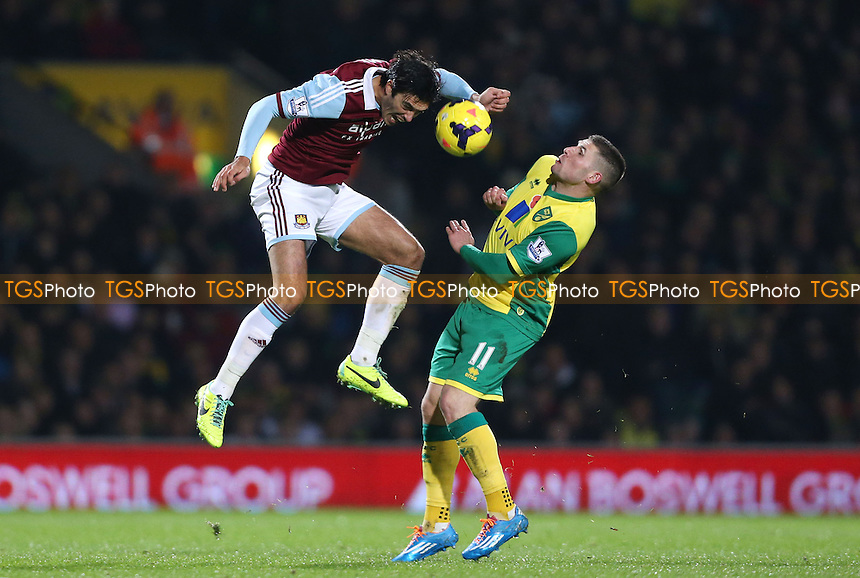 James Tomkins of West Ham and Gary Hooper of Norwich - Norwich City vs West Ham United, Barclays Premier League at Carrow Road, Norwich - 09/11/13 - MANDATORY CREDIT: Rob Newell/TGSPHOTO - Self billing applies where appropriate - 0845 094 6026 - contact@tgsphoto.co.uk - NO UNPAID USE
