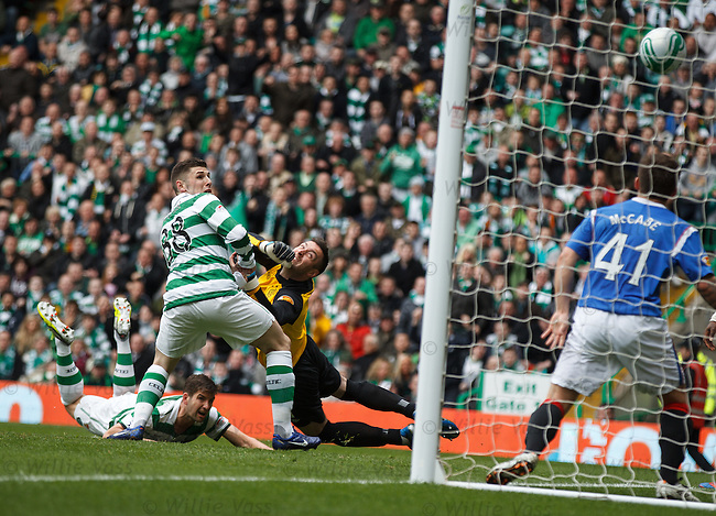 Charlie Mulgrew scores for Celtic with a diving header