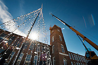 Workers prepare to install the Christmas tree that will be placed on the front tower of The Mill at MSU Conference Center. The tree will help light up Starkville during the holiday season.<br />
