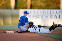 Dunedin Blue Jays second baseman Cavan Biggio (4) puts a tag on Ronald Acuna (27) as he slides into second base during a game against the Florida Fire Frogs on April 10, 2017 at Osceola County Stadium in Kissimmee, Florida.  Florida defeated Dunedin 4-0.  (Mike Janes/Four Seam Images)