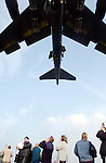 A B52  bomber returns to RAF Fairford  after a  bombing mission to Bagdhad during the war against Iraq. Passing over the  gathered crowds that have come to spectate..(note that none of the bombs on the wings have been dropped).