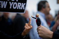 NEW YORK, NY - May 04: An activist gives a middle finger to a toy of U.S. president Donald Trump as she takes part in a protest near the USS Intrepid where U.S. president is hosting the visit of Australian Prime Minister Malcolm Turnbull late today after a delay on his schedule on May 4, 2017 in New York City. US President Donald Trump is returning to NYC after taking office in Washington as president,  Photo by VIEWpress/Eduardo MunozAlvarez