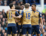 Danny Welbeck of Arsenal is mobbed as he celebrates his goal during the Barclays Premier League match at The Goodison Park Stadium. Photo credit should read: Simon Bellis/Sportimage