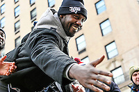 February 4, 2015 - Boston, Massachusetts, U.S. -  New England Patriots defensive end Chandler Jones (95) reaches out to fans during a parade held in Boston to celebrate the team's victory over the Seattle Seahawks in Super Bowl XLIX. Eric Canha/CSM