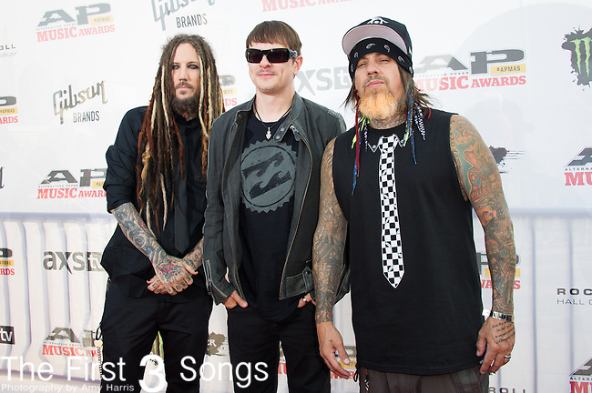 Reginald Arvizu, Brian Welch, and Ray Luzier of Korn attends the 2014 AP Music Awards at the Rock And Roll Hall Of Fame and Museum at North Coast Harbor in Cleveland, Ohio.