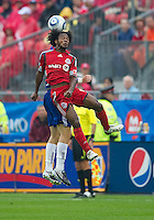 July 24, 2010  Toronto FC midfielder Julian de Guzman #6 out jumps FC Dallas defender/midfielder Brek Shea #20 for a ball during a game between FC Dallas and Toronto FC at BMO Field in Toronto..Final score was 1-1.