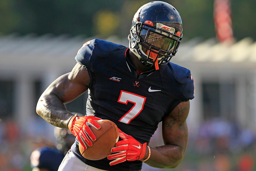 Virginia defensive end Eli Harold (7) picks up a fumble then scores a touchdown during the third quarter of the game Saturday Sept. 6, 2014 at Scott Stadium in Charlottesville, VA. Virginia defeated Richmond 45-13. Photo/Andrew Shurtleff