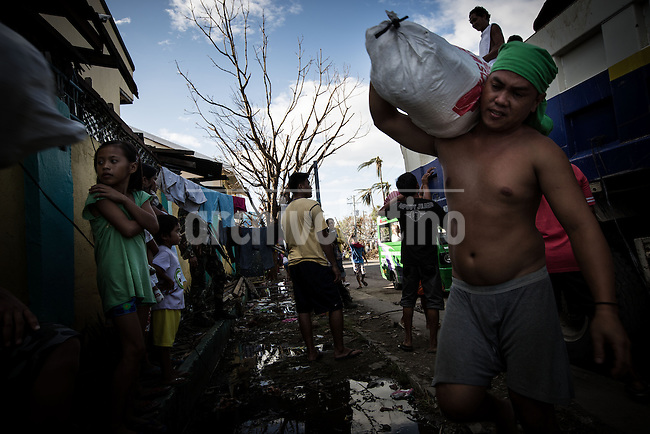 Devastation all over the town of Tacloban by the typhoon known as Haiyan or Yolanda in Philippines. In this city at least  780 bodies had been retrieved . Many more bodies are still expected to be located and buried.<br /> Overwhelmed by the scale of devastation, government officials here took several days to assemble the workers and equipment necessary to undertake the grim task.