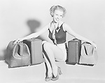 Young woman with old bags