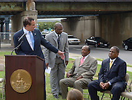 August 25, 2011 (Washington, DC)  On August 25, 2011, DC Mayor Vincent Gray (D-DC) (standing left) held a press conference announcing the designation of the Southeast/Southwest Freeway, the 11th Street Bridge and sections of Maine and Independence Avenues SW as Martin Luther King, Jr. Drive.  Also attending were Terry Bellamy, Director, DDOT (standing right), and Councilmembers Marion Barry Jr. (D-Ward 8) (seated center) and Vincent Orange (D-At Large) (seated right), and Harry E. Johnson Sr., president & CEO of the Martin Luther King, Jr. National Memorial Project Foundation, Inc.  (Photo by Don Baxter/Media Images International)