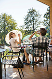 USA, Oregon, Willamette Valley, a group of travelers enjoy some wine and conversation outside on the patio at Sokol Blosser Winery, Dayton