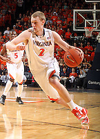Virginia guard Paul Jesperson (2) handles the ball during the game Tuesday in Charlottesville, VA. Virginia defeated Virginia Tech73-55.