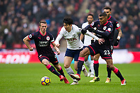 Tottenham Hotspur's Son Heung-Min holds off the challenge from Huddersfield Town's Collin Quaner <br /> <br /> Photographer Craig Mercer/CameraSport<br /> <br /> The Premier League - Tottenham Hotspur v Huddersfield Town - Saturday 3rd March 2018 - Wembley Stadium - London<br /> <br /> World Copyright &copy; 2018 CameraSport. All rights reserved. 43 Linden Ave. Countesthorpe. Leicester. England. LE8 5PG - Tel: +44 (0) 116 277 4147 - admin@camerasport.com - www.camerasport.com