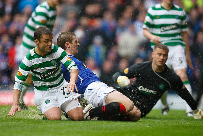 Steven Davis slides in to score for Rangers