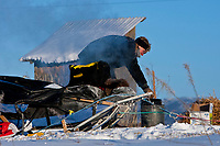 Kristy Berington heats water at the village checkpoint of Ruby in Interior Alaska during the 2010 Iditarod