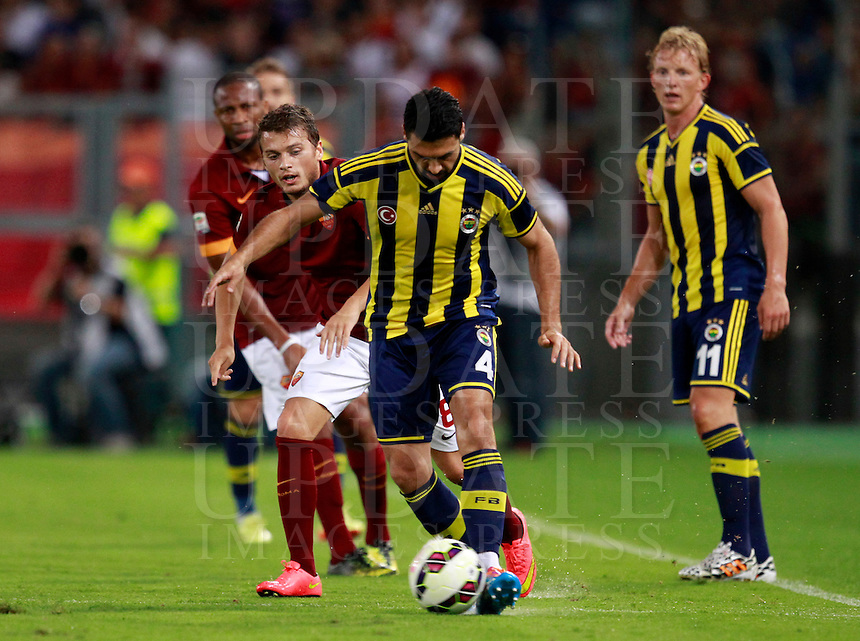 Calcio, amichevole Roma vs Fenerbahce. Roma, stadio Olimpico, 19 agosto 2014.<br /> Fenerbache midfielder Bekir Irtegur, center, is chased by Roma forward Adem Ljajic, of Serbia, left, during the friendly match between AS Roma and Fenerbahce at Rome's Olympic stadium, 19 August 2014.<br /> UPDATE IMAGES PRESS/Isabella Bonotto
