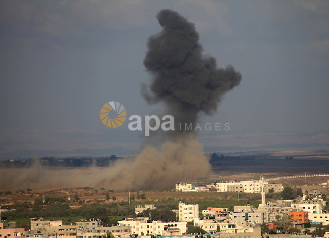 A picture take on August 09, 2014 shows smoke rising as Israeli military forces launch an airstrike on Gaza City. Israel will not engage in talks to end the violence in Gaza while coming under fire, Prime Minister Benjamin Netanyahu said. Photo by Mohammed Othman