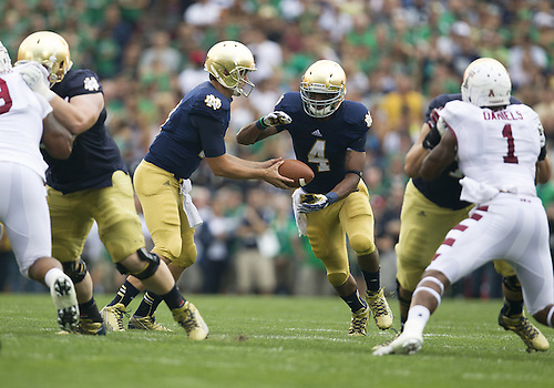 August 31, 2013:  Notre Dame quarterback Tommy Rees (11) hands the ball to running back George Atkinson III (4) during NCAA Football game action between the Notre Dame Fighting Irish and the Temple Owls at Notre Dame Stadium in South Bend, Indiana.  Notre Dame defeated Temple 28-6.
