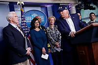 US President Donald J. Trump, with Vice President Mike Pence (L), administrator of the Centers for Medicare and Medicaid Services Seema Verma (C) and members of the COVID-19 coronavirus task force, responds to a question from the news media during a press conference in the press briefing room at the White House in Washington, DC, USA, 14 March 2020. To date there are 2175 confirmed cases of COVID-19 coronavirus in the US with 50 deaths.<br /> Credit: Shawn Thew / Pool via CNP/AdMedia