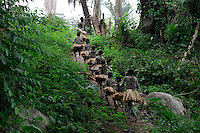 The nKumbi (manhood training) Pygmy group goes off into the forest to accompany the net hunters.  These Pygmy kids will have a five month training and then they will have to survive on their own and feed their families.  It's like when they drop off the marines in some remote jungle with three matches and a fork--but this is not a week's training--it is for the rest of their lives.