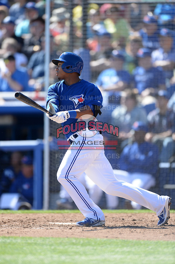 Toronto Blue Jays outfielder Moises Sierra (14) during a spring training game against the Pittsburgh Pirates on February 28, 2014 at Florida Auto Exchange Stadium in Dunedin, Florida.  Toronto defeated Pittsburgh 4-2.  (Mike Janes/Four Seam Images)
