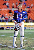 New York Giants quarterback Phil Simms (11) prior to the game against the Washington Redskins at RFK Stadium in Washington, DC on December 7, 1986.<br /> Credit: Arnie Sachs / CNP