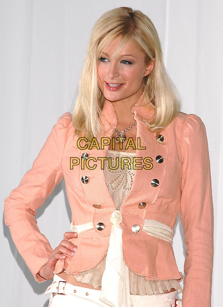 "PARIS HILTON.Poses with her wax counterpart at Madame Tussauds Wax Museum in New York's Times Square to promote her new film, ""House of Wax"".  .May 2nd, 2005.Photo Credit: Patti Ouderkirk/AdMedia.half length peach suit jacket hand on hip.www.capitalpictures.com.sales@capitalpictures.com.© Capital Pictures."