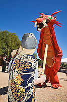 The Renaissance Fair is held each September at the historic museum of El Rancho de Las Golondrinas near Santa Fe and features dancers, kinghts, acrobats and many other performers all celebrating the culture and life style of the Medieval Middle Ages. A young kinght faces a ferocious red dragon.