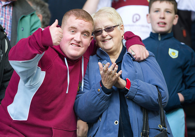 Burnley fans celebrate their teams win at the fianl whistle..Football - npower Football League Championship - Derby County v Burnley - Saturday 22nd September 2012 - Pride Park - Derby..