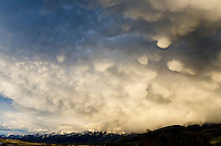 Thunderstorm clouds over Yellowstone River Valley in southern Montana.  May.