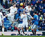 Rob Kiernan nips in between Stephen McManus, Ben Heneghan and Louis Moult to clear the danger