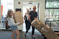 Just in from Brooklyn, NY - Emma Harwood '21 carries boxes while her parents Rockwell and Michelle help her as she moves into Chilcott Hall. Incoming first-years and their families are welcomed by O-Team members and the community at the start of Occidental College's Fall Orientation for the class of 2021, Aug. 24, 2017.<br /> (Photo by Marc Campos, Occidental College Photographer)