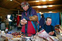 D.Halverson prepares food @ Ruby ckpt / '96 Iditarod