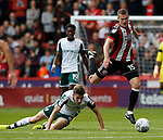 Paul Coutts of Sheffield Utd jumps over Joe Williams of Barnsley during the Championship League match at Bramall Lane Stadium, Sheffield. Picture date 19th August 2017. Picture credit should read: Simon Bellis/Sportimage