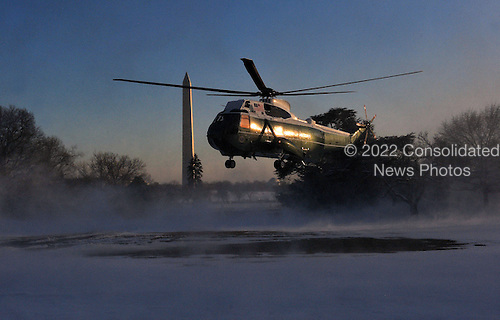 Marine One, with United States President Barack Obama aboard, blows snow at the press as it lands on the South Lawn of the White House March 6, 2015 in Washington, DC. President Obama traveled to Columbia, South Carolina for a town hall at Benedict College.<br /> Credit: Olivier Douliery / Pool via CNP