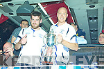 Captain Niall Mitchell and Ciaran 'Shank'O'Callaghan arrive home with the cup on the team bus on Saturday