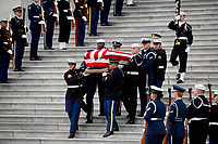 The flag-draped casket of former President George H.W. Bush is carried by a joint services military honor guard from the U.S. Capitol, Wednesday, Dec. 5, 2018, in Washington. <br /> Credit: Alex Brandon / Pool via CNP / MediaPunch