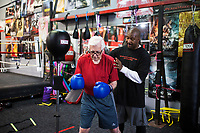 NWA Democrat-Gazette/CHARLIE KAIJO (From right) Coach Kevin Lightburn gives instructions to John Tolleson of Fayetteville during boxing class, Monday, June 11, 2018 at  Straightright Boxing and Fitness in Springdale.<br />