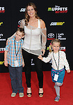 "Alison Sweeney and her kids arriving at Disney's ""Muppets Most Wanted"" Los Angeles Premiere, held at El Capitan Theatre March 11, 2014."