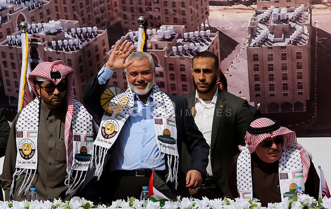 Hamas leader Ismail Haniyeh waves during the ceremony of the second phase of the Sheikh Hamad Town, in Khan Younis in the southern Gaza strip, on February 11, 2017. Photo by Ashraf Amra