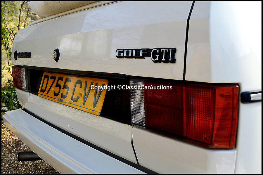 BNPS.co.uk (01202 558833)Pic: ClassicCarAuctions/BNPS<br /> <br /> An eighties' hot-hatch Only Fools and Horses star Sir David Jason once bought for his late partner has sold for almost £18,000.<br /> <br /> The legendary actor's purchase of the 1987 Volkswagen Golf GTi mimics the storyline in the hit sitcom when Del Boy bought a Ford Capri for his partner Raquel. <br /> <br /> In another episode Del used a play on the term 'GTi' to call dodgy car dealer friend Boycie a 'git'.<br /> <br /> Sir David bought the white convertible Golf as a gift for his late partner Myfanwy Talog in 1988, during the height of Only Fools and Horses.