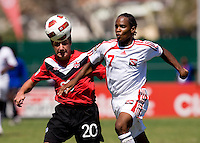 Michael Petrasso (20) of Canada fights for the ball with Neil Benjamin (7) of Trinidad & Tobago during the quarterfinals of the CONCACAF Men's Under 17 Championship at Catherine Hall Stadium in Montego Bay, Jamaica. Canada defeated Trinidad & Tobago, 2-0.