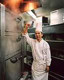 SINGAPORE, Asia, portrait of happy chef standing by oven at Orchard Hotel