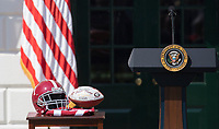 Ceremonial presentation helmet and football are on display at the welcoming ceremony of the 2017 NCAA Football National Champions: The Alabama Crimson Tide to the White House in Washington, DC, March 10, 2018. <br /> CAP/MPI/RS<br /> &copy;RS/MPI/Capital Pictures