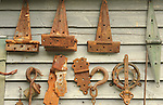 Super's Junkin Company. Rusty hinges on clapboard.