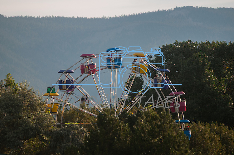 Fairgoers ride the ferris wheel during the NV150 Fair at Fuji Park in Carson City, Nev., on Saturday, August 2, 2014.<br /> (Photo By Kevin Clifford)